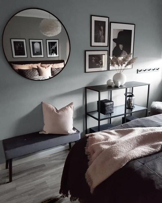 Cuarto con paredes grises y suelo laminado color gris